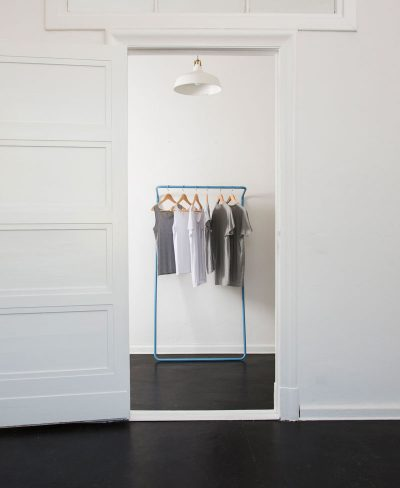 wall-leaning-clothes-rack-mood-image-blue