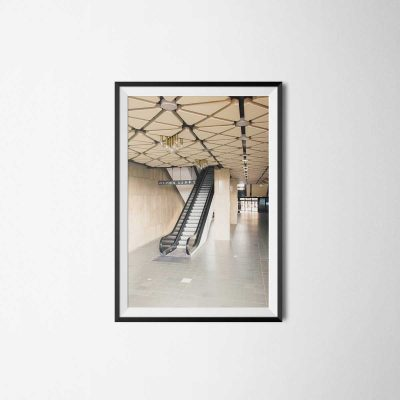 escalator in the lobby of a brutalist building